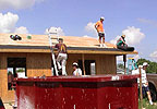 Habitat for Humanity builds a house.
