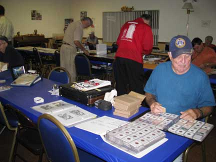 Coin dealer showing coins for sale
